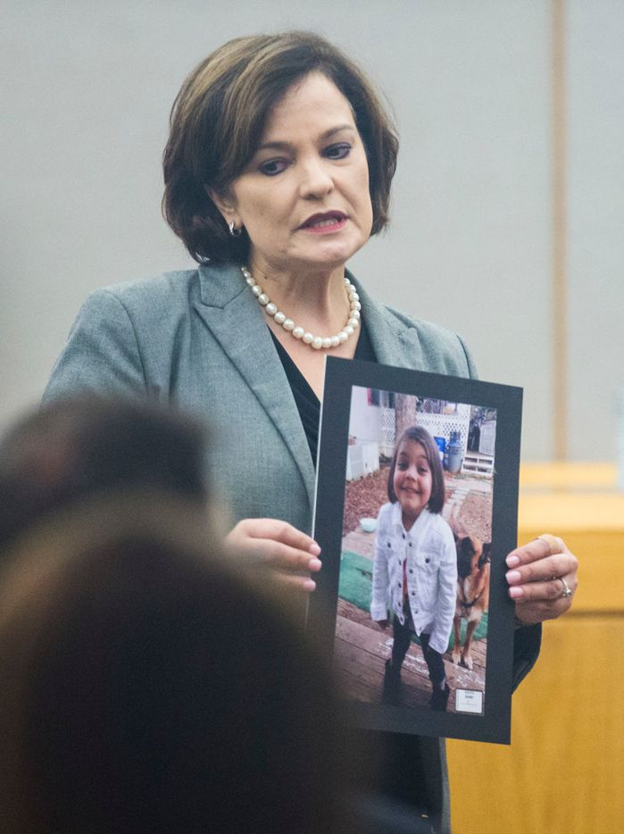 Prosecuting attorney Erin Price shows a photo of 4-year-old Leiliana Wright, who was beaten to death in March 2016, during her opening statement in a trial charging Charles Phifer with felony injury to a child on Wednesday, October 10, 2018 at the Frank Crowley Courts Building in Dallas. (Ashley Landis/The Dallas Morning News)