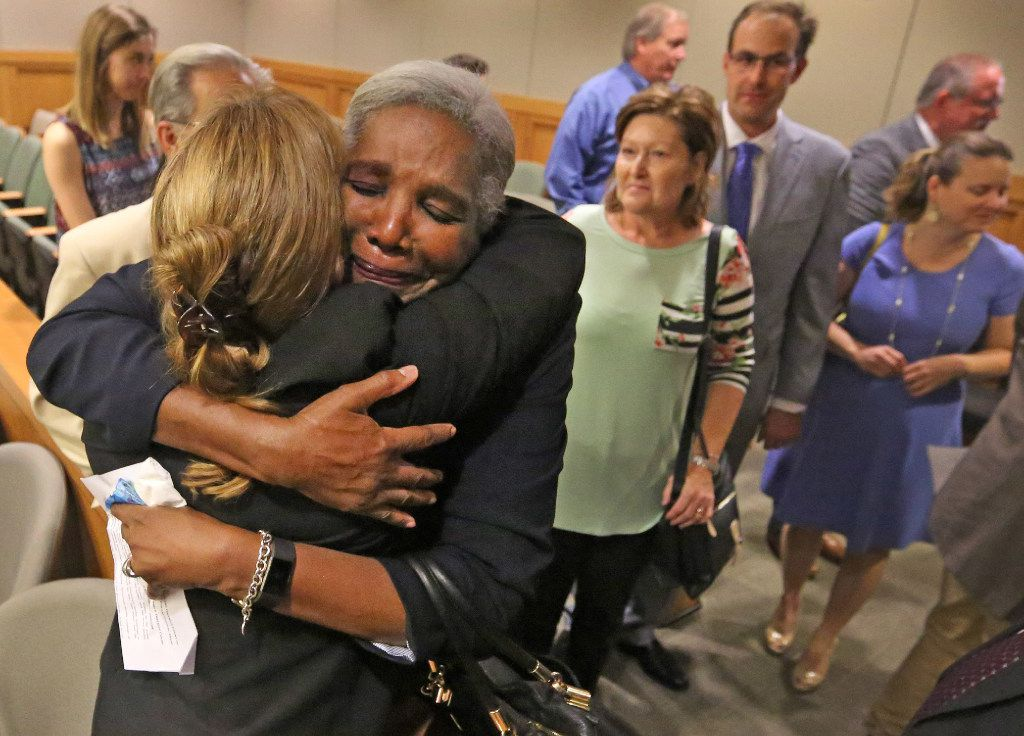 Former Judge Suzanne Wooten (left, back to camera) gets a hug from Cynthia Fitzgerald Lacy after Wooten's 2011 convictions are vacated in the 416th District Court in McKinney on May 24, 2017. (File photo)