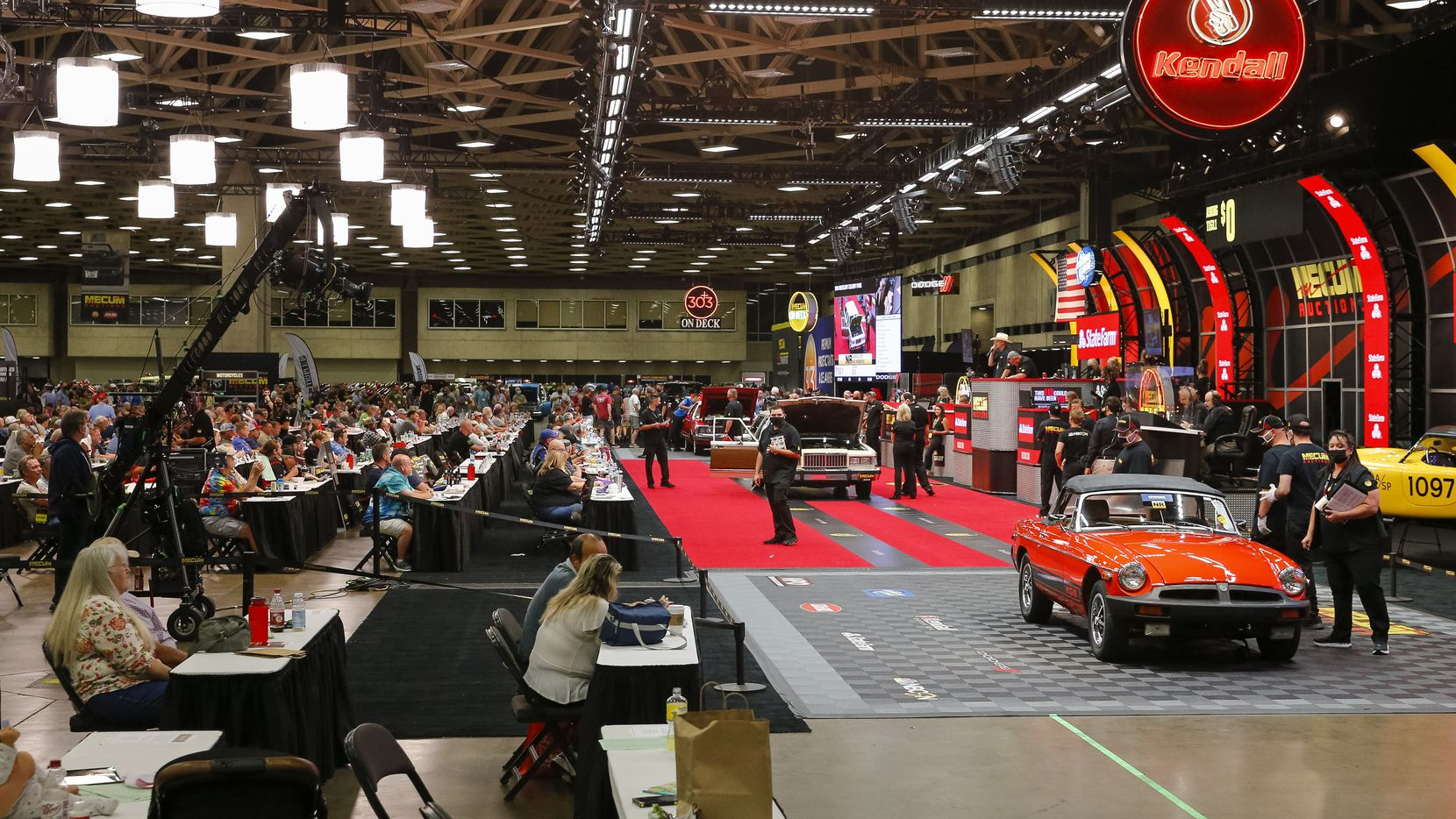 Bidders gathered at the Kay Bailey Hutchison Convention Center Thursday for Mecum Auctions' multi-day collector car event.