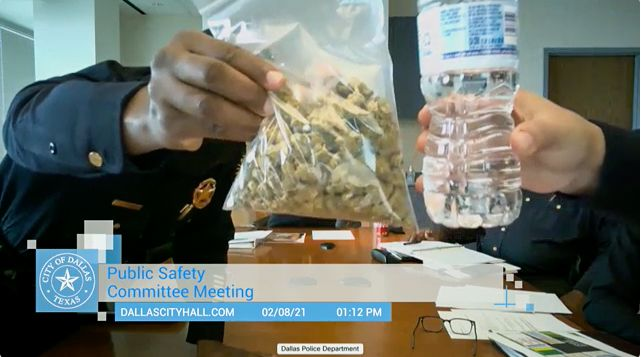 A bag of marijuana is held up during Dallas Police Chief Eddie Garcia's first public safety committee meeting as chief, which was held virtually, in Dallas on Monday, Feb. 8, 2021.