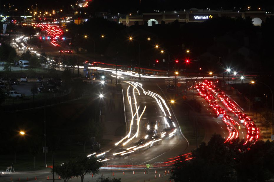 Traffic leaves the Texas Rangers baseball game as concertgoers leave AT&T Stadium on Randol Mill Road.