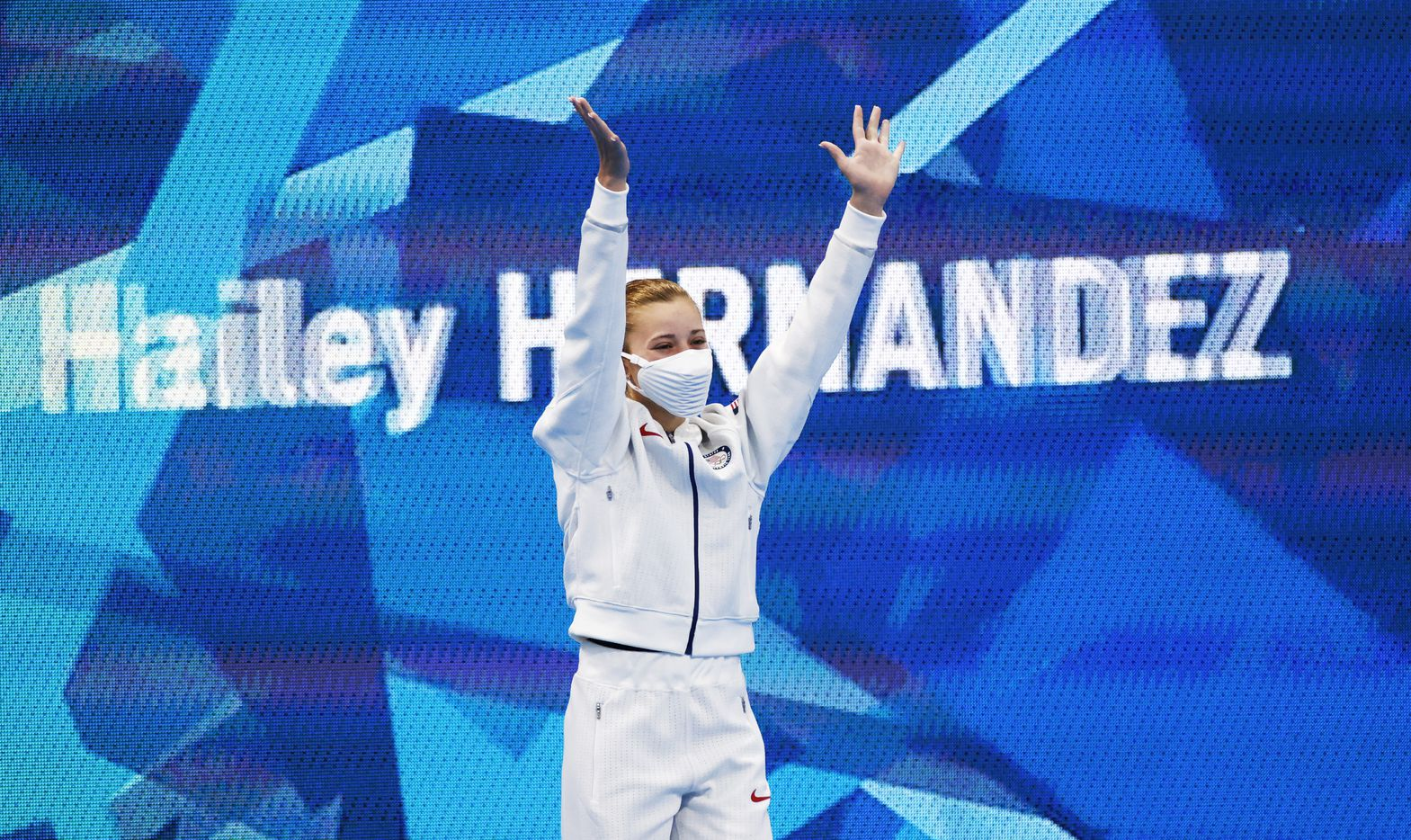 USA's Hailey Hernandez waves as she is introduced before the start of the women's 3 meter springboard semifinal competition during the postponed 2020 Tokyo Olympics at Tokyo Aquatics Centre, on Saturday, July 31, 2021, in Tokyo, Japan. (Vernon Bryant/The Dallas Morning News)