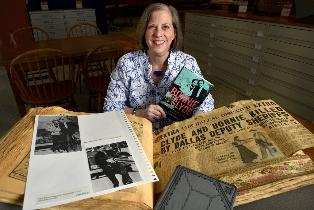 Dallas writer Karen Blumenthal with archival items she researched to write about Bonnie and Clyde at the J. Erik Jonsson Central Library in downtown Dallas.