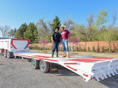 Kristian Roberts, director of education at the Dallas Opera, and Quincy Roberts, CEO of Roberts Trucking, pose with the OperaTruck, donated to the Dallas Opera and retrofitted by Quincy Roberts and Roberts Trucking.