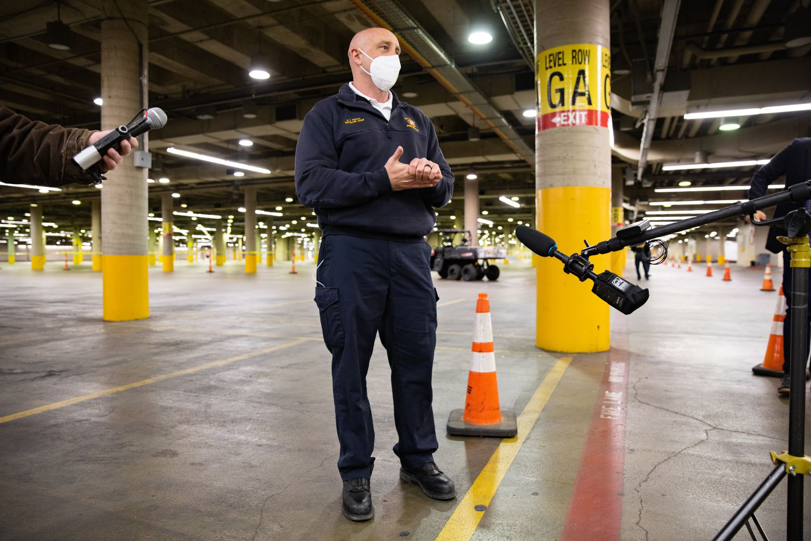 Scott Pacot, Battalion Chief with Dallas Fire-Rescue, talks to the media about the drive-up vaccination site at the Kay Bailey Hutchison Convention Center in Dallas on Wednesday, Jan. 27, 2021. (Juan Figueroa/ The Dallas Morning News)