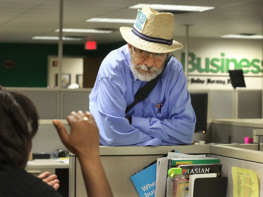 Weiss listens to Arnessa Garrett, an editor in the business department at the newspaper.
