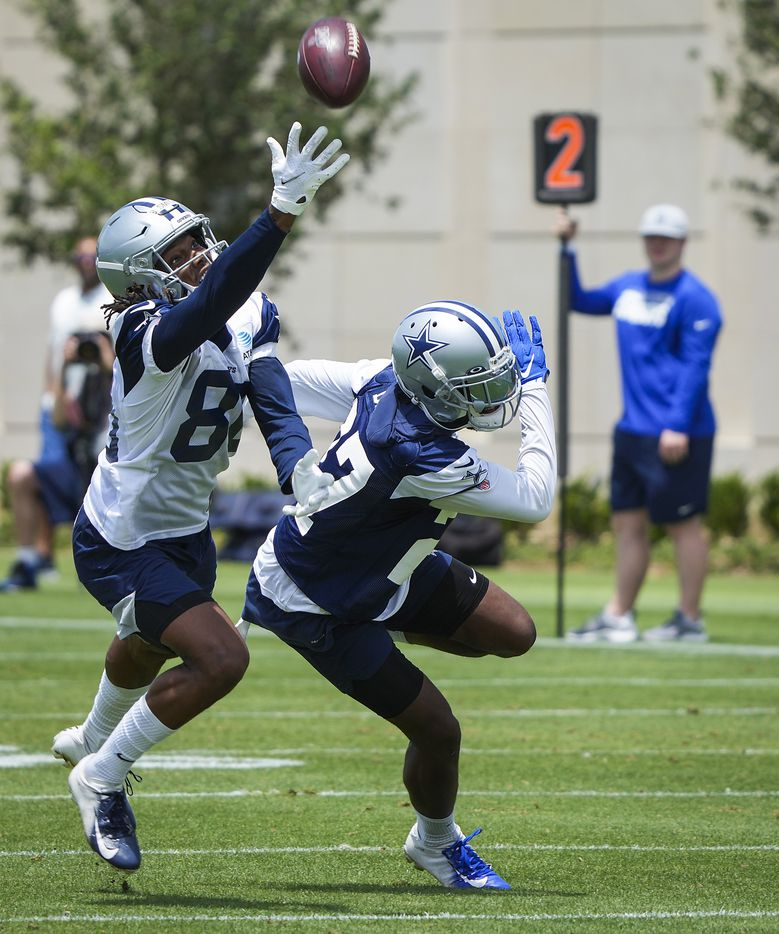 Dallas Cowboys wide receiver Brandon Smith (80) can't make a catch as cornerback Trevon Diggs (27) defends during a minicamp practice at The Star on Tuesday, June 8, 2021, in Frisco. (Smiley N. Pool/The Dallas Morning News)