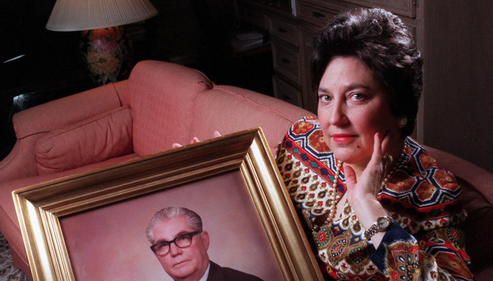 Camille Keith (at right) posed with a portrait of her late father, Marvin Keith, in 1996 as she spoke out about her work as an ombudsman for the elderly who are confined to nursing homes.