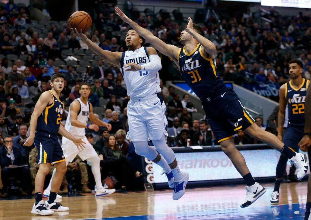 Dallas Mavericks guard Jalen Brunson (13) attempts a layup as he is defended by Utah Jazz forward Georges Niang (31) during the second half of play at American Airlines Center in Dallas on Wednesday, November 14, 2018. Dallas Mavericks defeated the Utah Jazz 118-68. (Vernon Bryant/The Dallas Morning News)