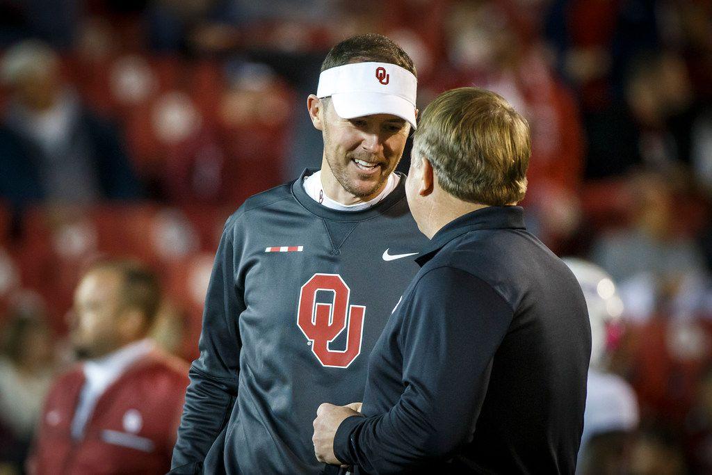 Oklahoma head coach Lincoln Riley chats with TCU head coach Gary Patterson before an NCAA football game in Norman, Okla., Saturday, Nov. 11, 2017.
