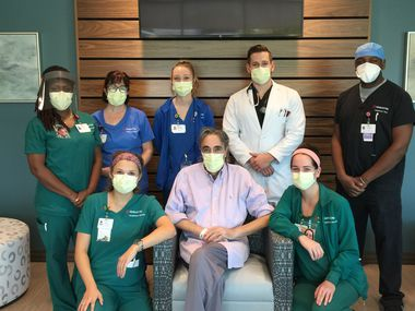 Ceasar Ronavez poses for a photo with the Inpatient Rehab team at Medical City McKinney. Ronavez spent more than 100 days in the hospital because of COVID-19, and the Inpatient Rehab crew cheered as he exited to begin home treatment.