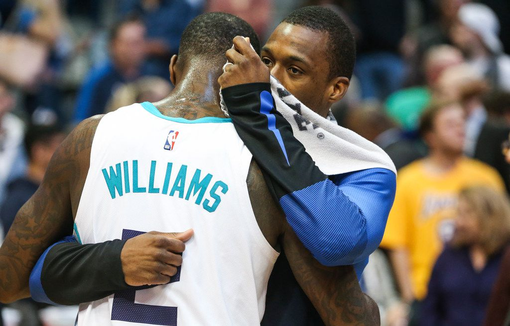 Dallas Mavericks forward Harrison Barnes (40), who was traded during the game, talks to Charlotte Hornets forward Marvin Williams (2) following a matchup between the Dallas Mavericks and the Charolette Hornets on Wednesday, Feb. 6, 2019 at the American Airlines Center in Dallas. (Ryan Michalesko/The Dallas Morning News)