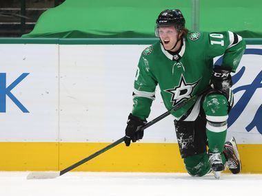 Dallas Stars Ty Dellandrea (10) is slow to get up after getting checked in a game against the Detroit Red Wings during the second period of play at American Airlines Center on Tuesday, January 26, 2021 in Dallas.