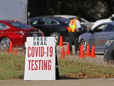 Cars wait in line to receive a COVID-19 oral testing kit at the Good Street Baptist Church testing site in Dallas, on Monday, Nov. 09, 2020.