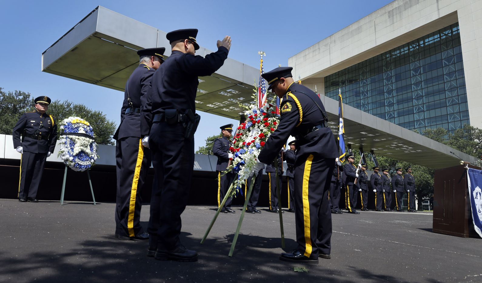 Dallas Police Chief Eddie Garcia salutes honor guard Gabriel Orosco before placing a 7-7 wreath in honor of the officers who died in the July 7th ambush. It was the 5th anniversary of the deadly day and special recognition was given to those officers who were killed during the 2021 Police Memorial Day at the Dallas Police Memorial in downtown Dallas, Wednesday, July 7, 2021. (Tom Fox/The Dallas Morning News)