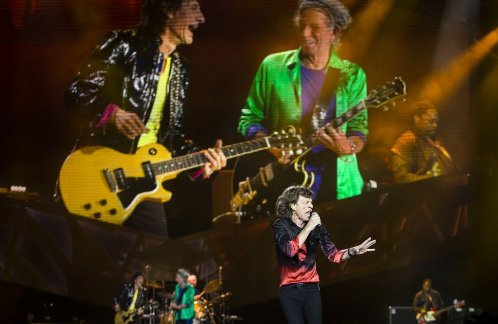 Mick Jagger of The Rolling Stones sings in front of larger than life images of Ronnie Wood and Keith Richards as they perform at AT&T Stadium as part of their Zip Code Tour of North America on Saturday, June 6, 2015, in Arlington, Texas. (Smiley N. Pool/The Dallas Morning News)