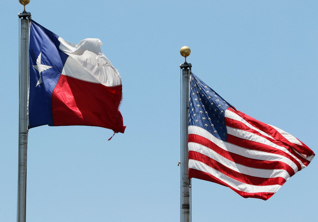 American and Texas flags are flown in Arlington on Monday, July 3, 2017. (David Woo/The Dallas Morning News)