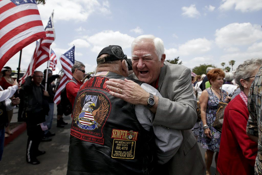 Former Vietnam POW Orson Swindle, right, gets a hug from Jim Janeway as he arrives to celebrate the 40th reunion of Vietnam POWs at the Richard Nixon Presidential Library & Museum in Yorba Linda, Calif., in 2013.