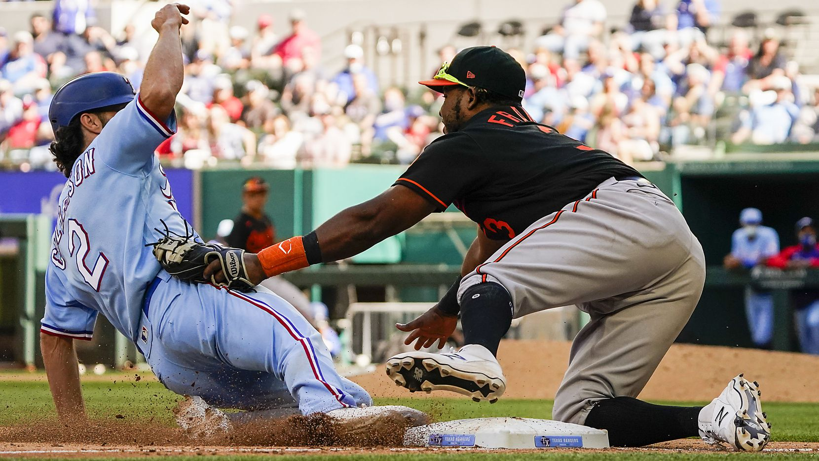 Texas Rangers infielder Charlie Culberson is out at third as Baltimore Orioles third baseman Maikel Franco applies the tag trying to advance on a bunt during the tenth inning of the Rangers 1-0 walkoff victory at Globe Life Field on Sunday, April 18, 2021. (Smiley N. Pool/The Dallas Morning News)