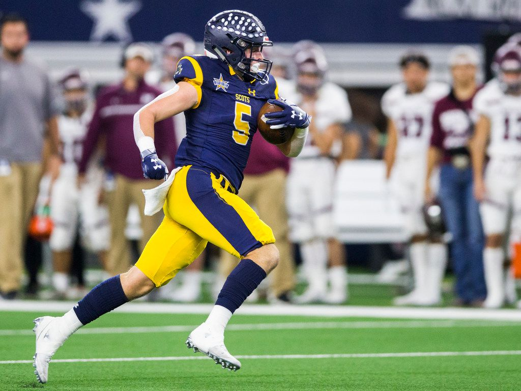 Highland Park receiver Case Savage (5) runs to the end zone for a touchdown during the first quarter of a Class 5A Division I area-round playoff game between Magnolia and Highland Park on Thursday, November 21, 2019 at AT&T Stadium in Arlington. (Ashley Landis/The Dallas Morning News)