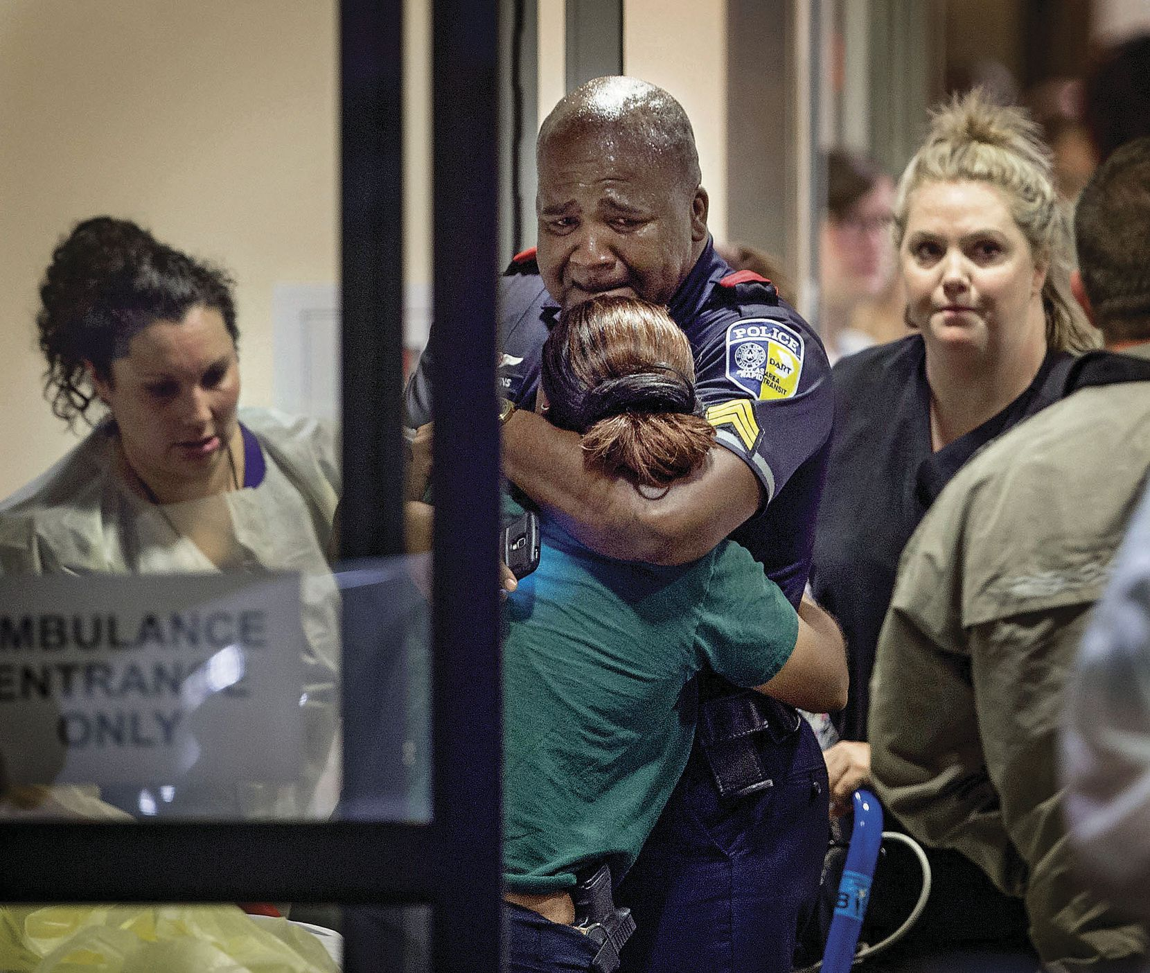 A Dallas Area Rapid Transit police officer was comforted at the Baylor University Hospital emergency room entrance on July 7. One of his colleagues on the DART police force, 43-year-old Officer Brent Thompson, was among those killed in the ambush. Thompson, a former Marine who had been with the department since 2009, was the first DART officer to be killed in the line of duty.