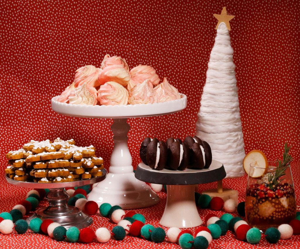 Gingerbread Snowflakes, Peppermint Meringues and Chocolate Marshmallow Whoopie Pies make for a lovely spread. (David Woo/Staff Photographer)