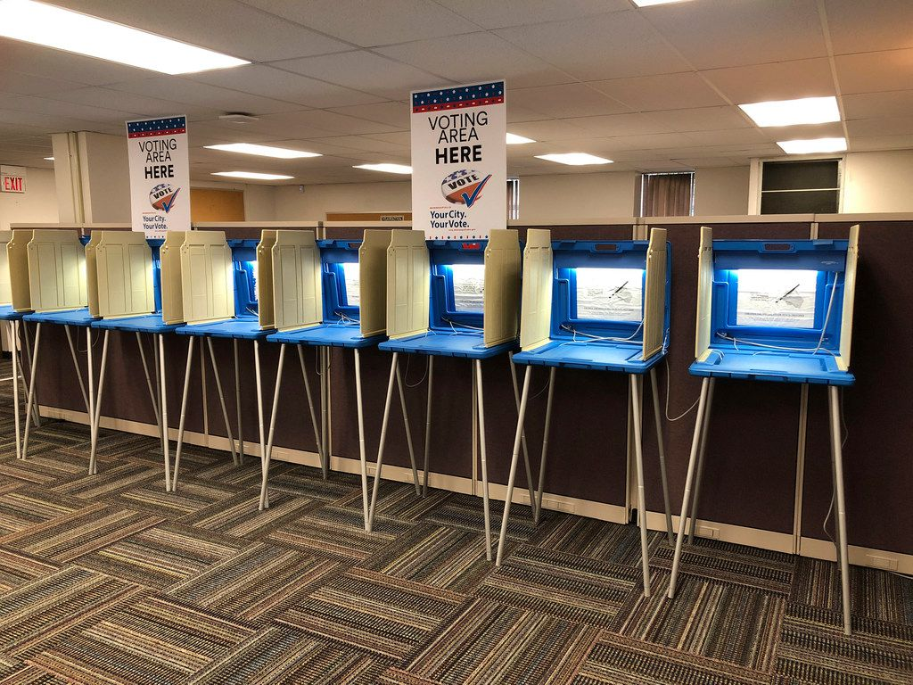 In this Sept. 20, 2018, photo, voting booths stood ready in downtown Minneapolis for the opening of early voting in Minnesota. Minnesota and South Dakota are tied for the earliest start in the country for early voting in the 2018 midterm elections. A new poll finds that a large majority of Americans are concerned the nation's voting systems might be vulnerable to hackers, with Democrats more concerned than Republicans.