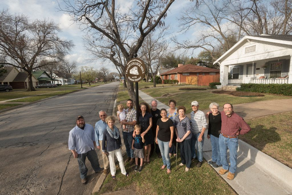 Residents who live in Garland's Travis College Hill district gather on the corner on March 6, 2017.  The one block street of Craftsman style houses has been approved for the National Register of Historic Places.   (Rex C. Curry/Special Contributor)