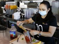 Lili Ventura made a michelada at El Tiz taqueria in Dallas in July. The taqueria is one of the companies that benefited from the Paycheck Protection Program.