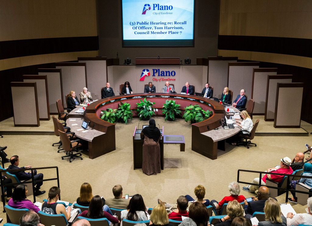 Plano resident Zeba Siddiqui, center, speaks against Plano City Council member Tom Harrison, second from left, during a hearing in which Harrison defended his post on social media about banning Islam in public schools on Monday, April 23, 2018 at Plano City Hall. The council is considering a recall of the November 6 election. (Ashley Landis/The Dallas Morning News)