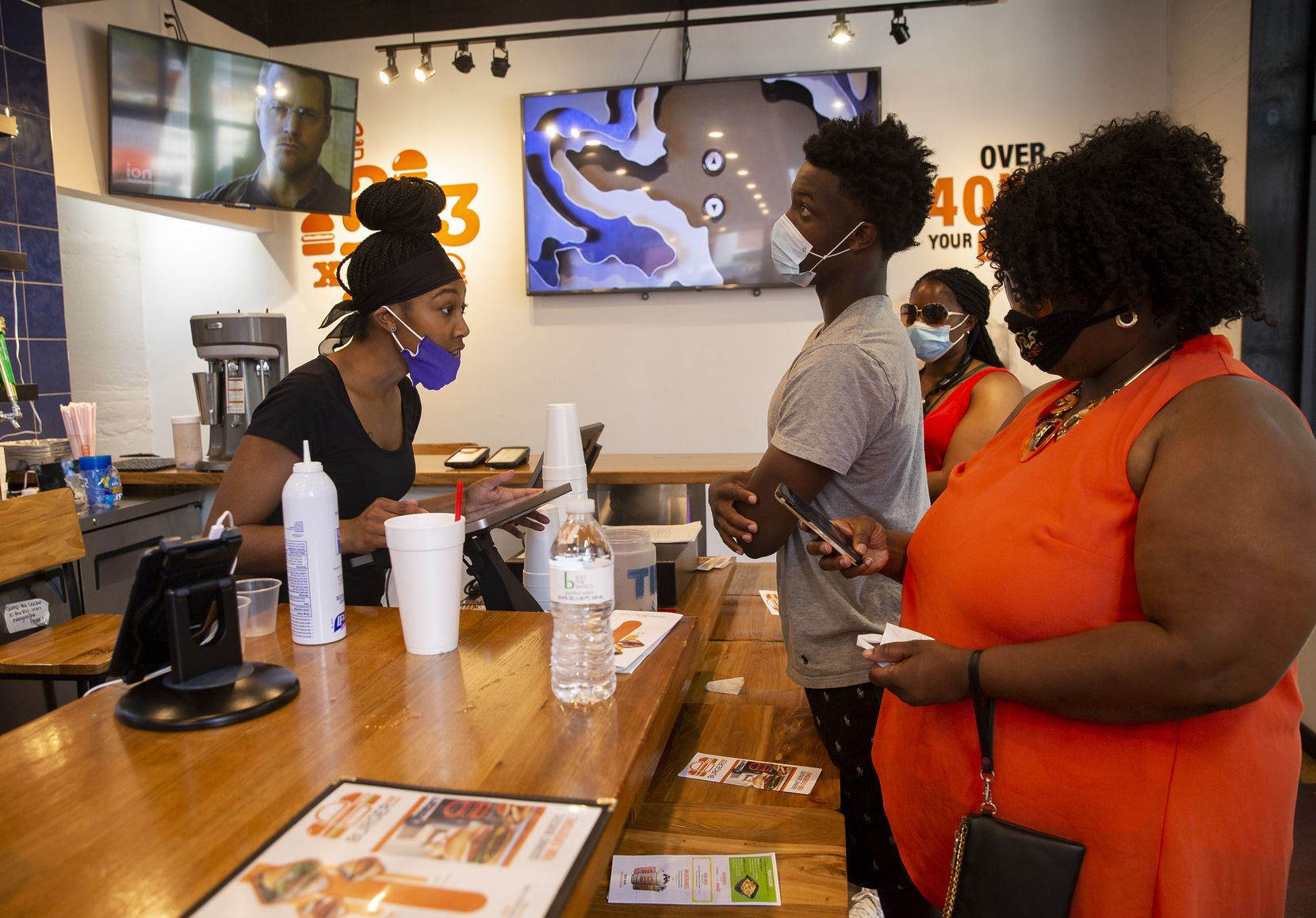 Mary Jones (left) takes orders at BurgerIM on Sunday, May 31, 2020 in Dallas. Many in the community have shown up to support the West End restaurant after it was damaged by protesters Friday night. (Juan Figueroa/ The Dallas Morning News)