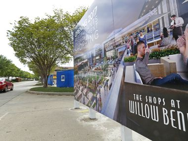 A car passes by a rendering sign displaying the $150 million renovation that was completed a couple years ago at The Shops at Willow Bend in Plano.