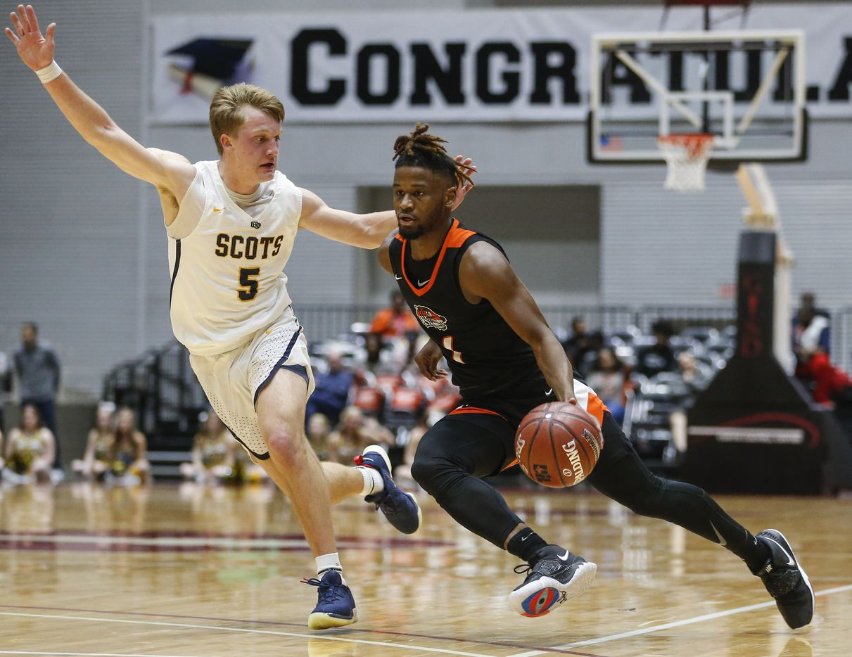 Lancaster's Mike Miles (1) drives past Highland Park's Drew Scott (5) during the first half of a boys basketball UIL Class 5A Region II semifinal between Lancaster and Highland Park on Friday, March 6, 2020 at Curtis Culwell Center in Garland, Texas.