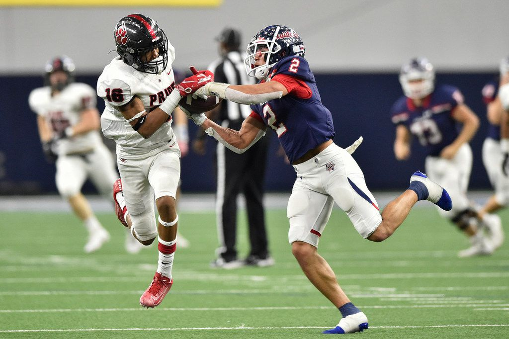 Ryan wide receiver Billy Bowman Jr. (2) and Heritage cornerback Dylahn Mckinney (16) battle for possession of the ball at the Ford Center at the Star, Dec. 7, 2019, in Frisco, Texas.