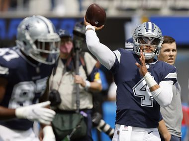 Dallas Cowboys quarterback Dak Prescott (4) throws during pregame warmups before their game against the Los Angeles Chargers at SoFi Stadium in Inglewood, California, Sunday, September 19, 2021.
