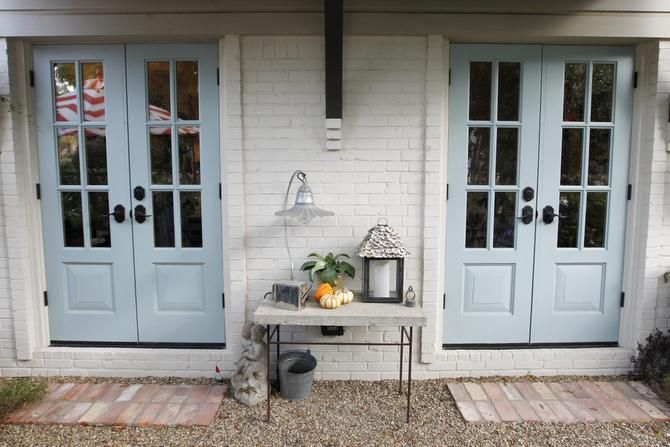 French doors connect the kitchen to a sunken garden.