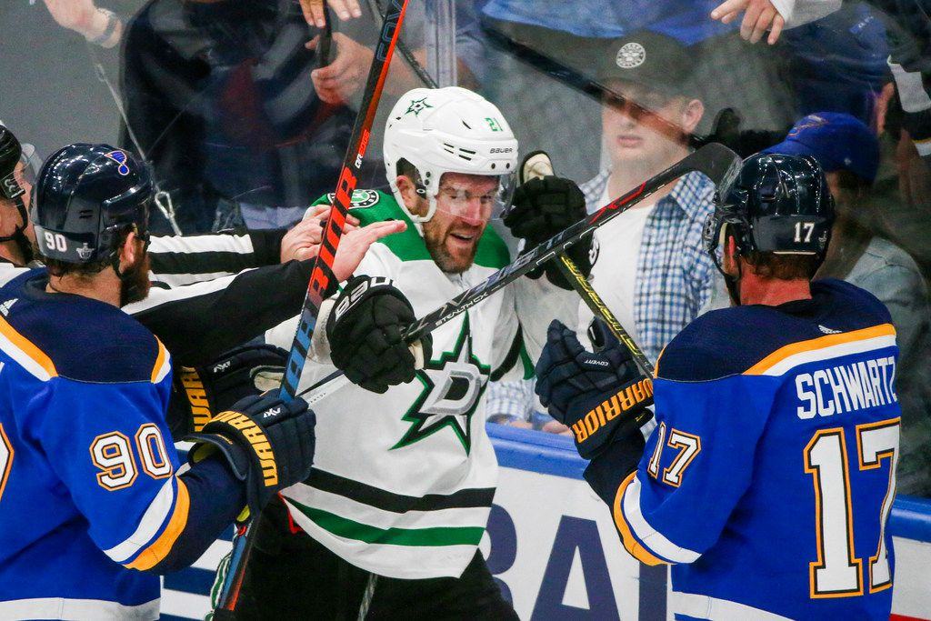 Dallas Stars defenseman Ben Lovejoy (21) gets into a fight with St. Louis Blues left wing Jaden Schwartz (17) following the third period in game 5 of an NHL second round playoff series at Enterprise Center in St. Louis, Missouri on Friday, May 3, 2019.(Shaban Athuman/Staff Photographer)