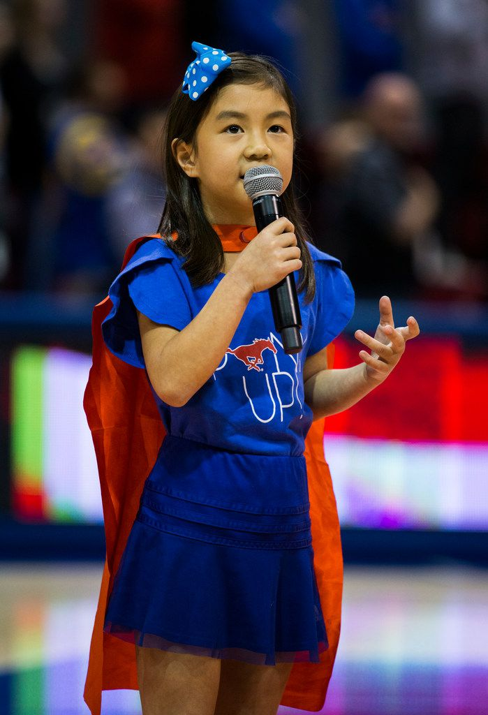 Lila Tran sings the national anthem before a basketball game between SMU and University of Houston on Saturday, February 15, 2020 at Moody Coliseum in Dallas. (Ashley Landis/The Dallas Morning News)