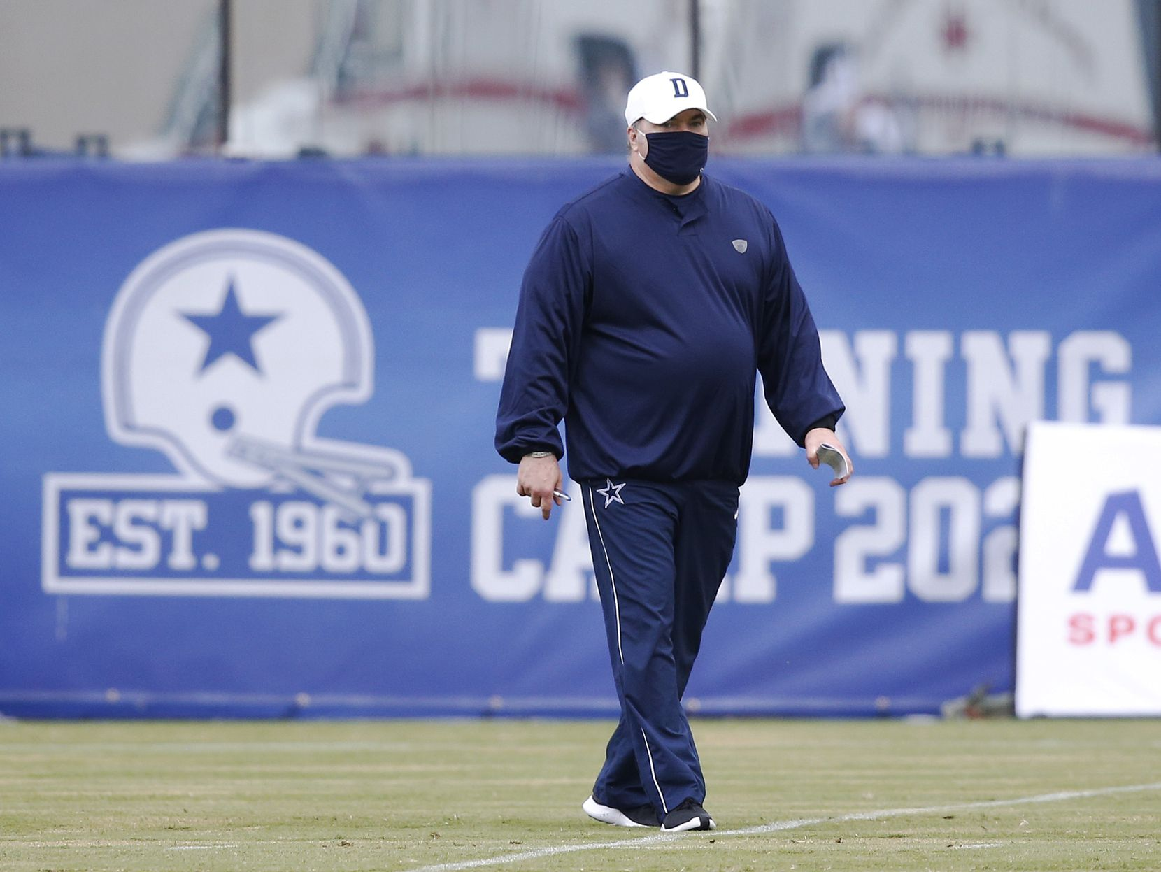 Dallas Cowboys head coach Mike McCarthy walks the field at practice during training camp at The Star in Frisco, Texas on Thursday, September 3, 2020.