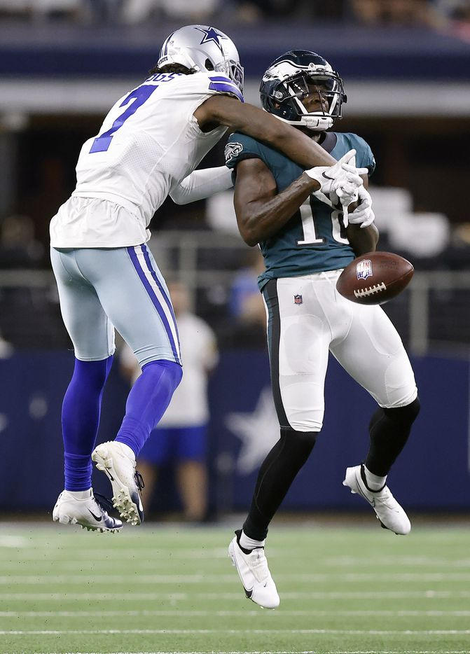 Dallas Cowboys cornerback Trevon Diggs (7) breaks up a pass intended for Philadelphia Eagles wide receiver Jalen Reagor (18) during the fourth quarter at AT&T Stadium in Arlington, Monday, September 27, 2021. The Cowboys won, 41-21. (Tom Fox/The Dallas Morning News)