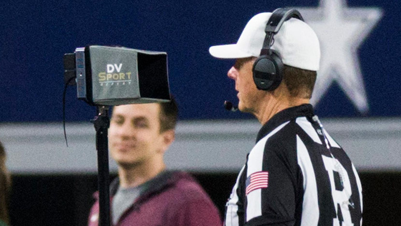 Referee Bill Tilley watches the instant replay screen on the sideline after a fumble turnover during the fourth quarter of the UIL 4A Division I state championship game between Waco La Vega and Liberty Hill on Friday, December 21, 2018 at AT&T Stadium in Arlington. (Ashley Landis/The Dallas Morning News)