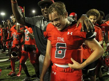 Cedar Hill Longhorns quarterback Garret McGuire (6) lets out a relieved sigh as he is congratulated by teammates and Longhorns supporters on the field following their come from behind 42-41 victory over Mansfield. The two Class 6A teams played their non-district football game at Longhorn Stadium in Cedar Hill on September 2, 2016. (Steve Hamm/Special Contributor