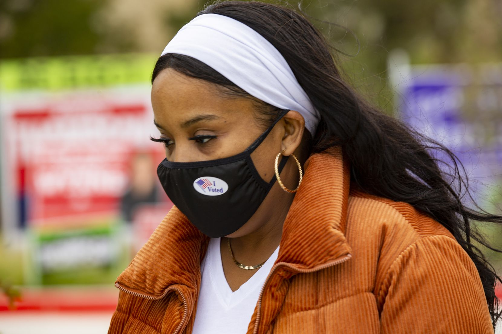 """Wanda Brooks wears an """"I voted"""" sticker on her mask after voting at the Collin College campus in Wylie on Thursday, Oct. 29, 2020. (Juan Figueroa/ The Dallas Morning News)"""