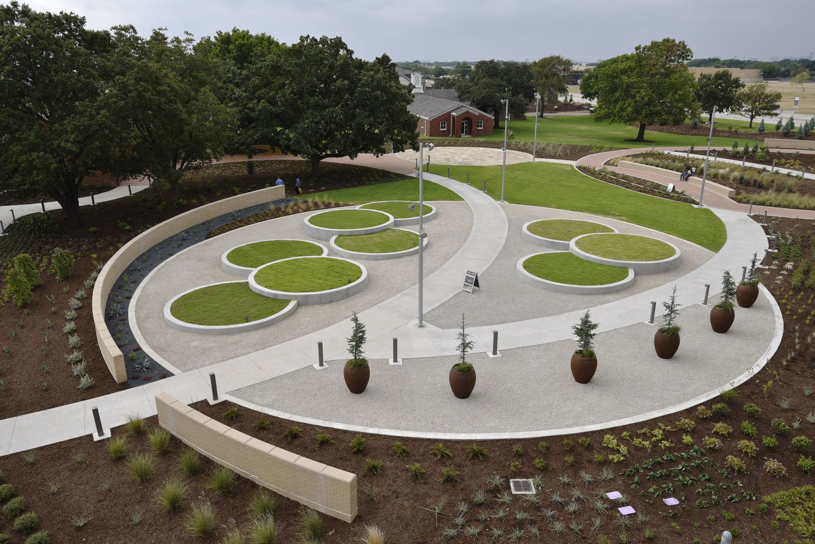 The Gardens at the Texas A&M AgriLife Center at Dallas during the grand opening. The circle beds of grass contain turfgrass varieties developed at the center.