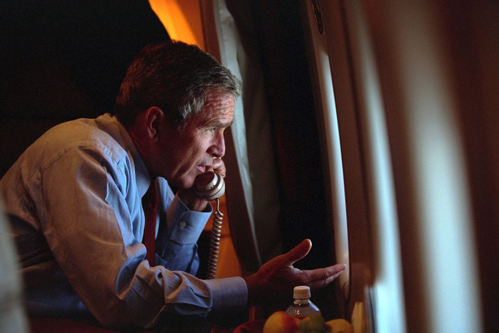 After departing Offutt Air Force Base in Nebraska, President George W. Bush confers with Vice President Dick Cheney from Air Force One on Tuesday, Sept. 11, 2001, during the flight to Andrews Air Force Base.  Photo by official White House photographer Eric Draper, Courtesy of the George W. Bush Presidential Library