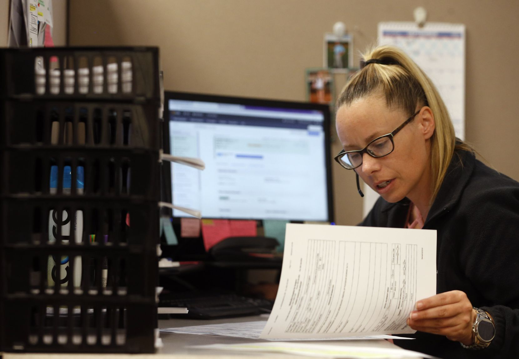 Jessica Hefley works on scheduling in the central scheduling office at Methodist Hospital for Surgery in Addison.
