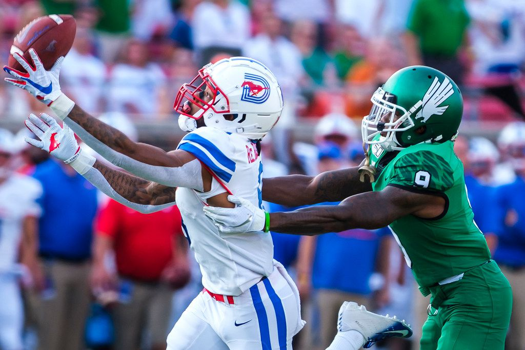 SMU wide receiver Reggie Roberson Jr. (8) has a pass go off his fingers as UNT defensive back Nick Harvey (9) defends during the first half of an NCAA football game at Ford Stadium on Saturday, Sept. 7, 2019, in Dallas. (Smiley N. Pool/The Dallas Morning News)