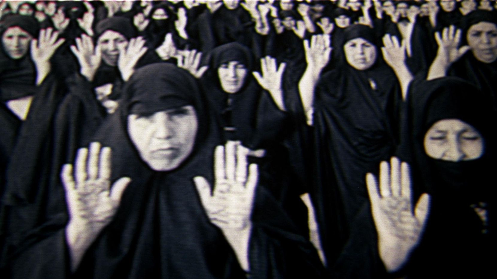A clip of artist Shirin Neshat's video installation 'Rapture, 1999' at Site Santa Fe in Santa Fe, N.M., was shown at the exhibition of her work at the Modern Art Museum of Fort Worth.