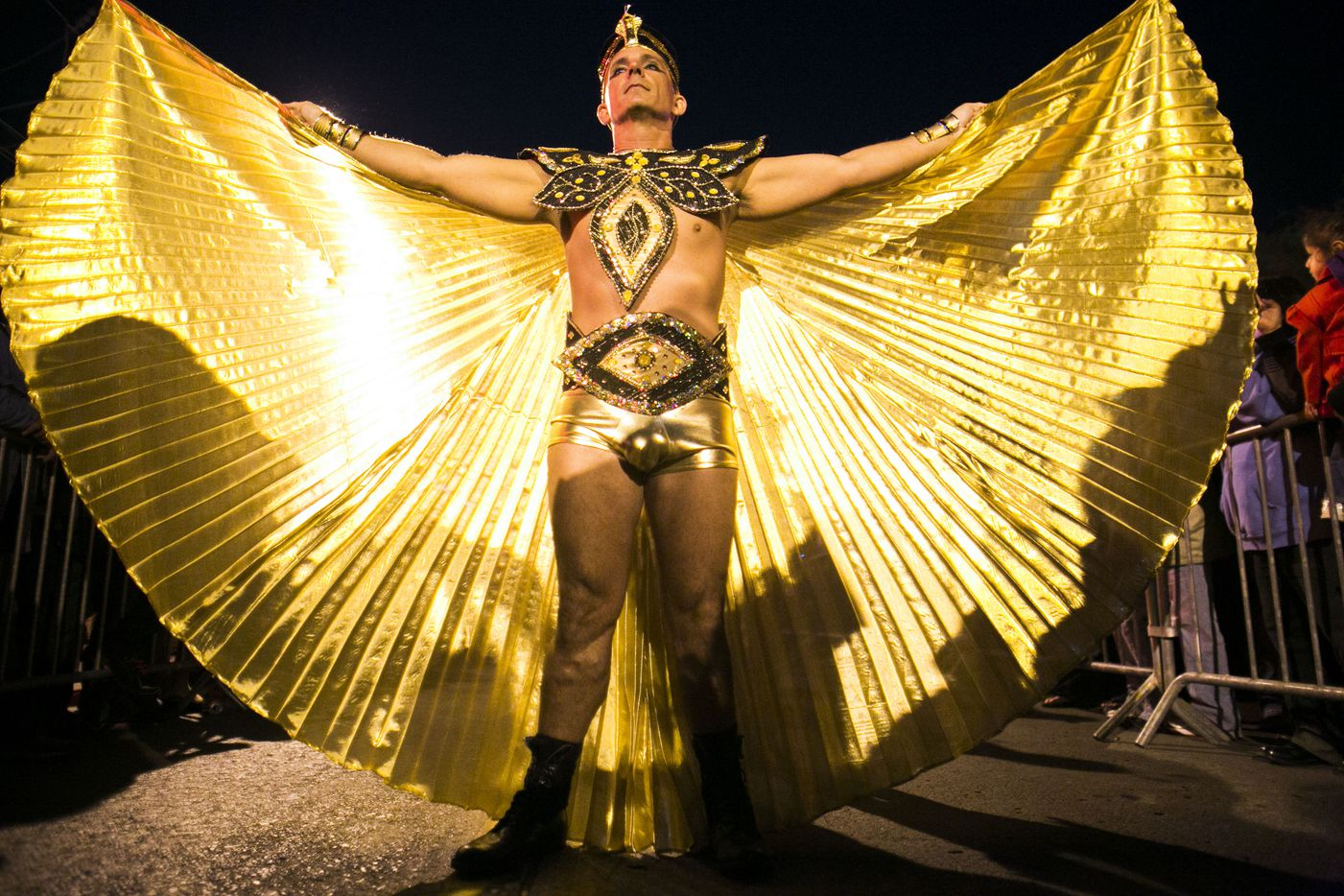 An egyptian themed costumer spreads his wings for the crowd on the 3900 block of Cedar Springs Road  for the Oak Lawn Halloween Street Party in Dallas on Saturday Oct. 27, 2012. (Christian Randolph/The Dallas Morning News)