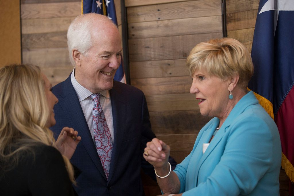 Sen. John Cornyn (R-Texas), second from left, and Heather DeLapp of Fort Worth listen to Fort Worth Mayor Betsy Price, right, before A Conversation with Cornyn, a luncheon at the Omni Hotel in Fort Worth, on Nov. 9, 2018. DeLapp was speaking with Price and Cornyn after she had her picture taken with them.